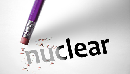 nuke plant: Eraser deleting the word Nuclear