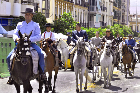 MALAGA, SPAIN - AUGUST, 14: Horsemen and carriages at the Malaga August Fair on August, 14, 2009 in Malaga, Spain