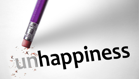 Eraser changing the word Unhappiness for Happiness Stock Photo