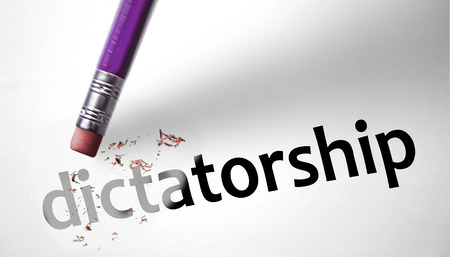 Eraser deleting the word Dictatorship  photo
