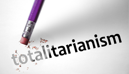 totalitarianism: Eraser deleting the word Totalitarianism