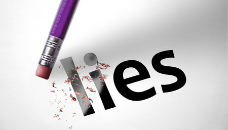two faced: Eraser deleting the word Lies  Stock Photo