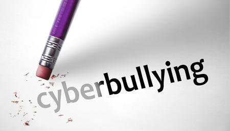 Eraser deleting the word cyberbullying Stock Photo