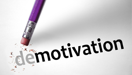 Eraser changing the word Demotivation for Motivation Stock Photo