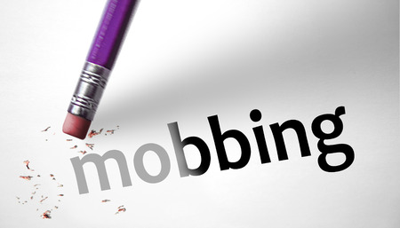 deleting: Eraser deleting the word Mobbing