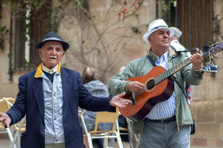 acoustical: MALAGA, SPAIN - APRIL 29: Two men playing spanish guitar and singing flamenco music in the streets, on April 29, 2009, in Malaga, Spain.