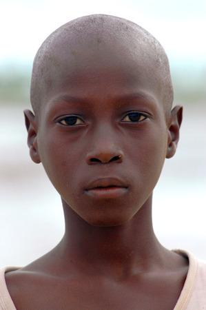 SENEGAL - SEPTEMBER 17: Boy from the island of Carabane smiling to camera, on September 17, 2007 in Carabane, Casamance, Senegal