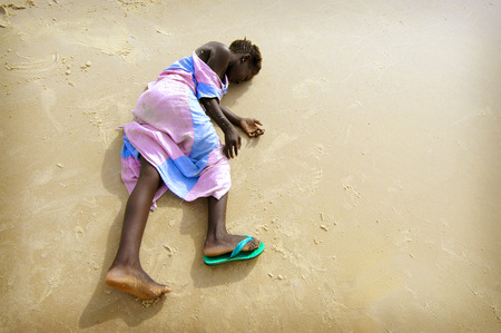 SENEGAL - SEPTEMBER 16: unidentified girl from the island of Carabane posing and playing with the camera, September 16, 2007 in Carabane, Casamance, Senegal
