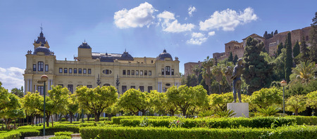 Pedro Luis Alonso gardens and the Town Hall building in Malaga, Spain. Stock Photo