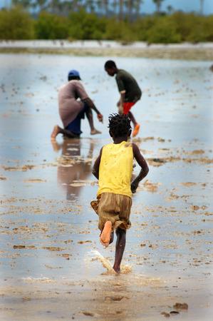 SENEGAL - SEPTEMBER 17: Little girl from the island of Carabane running away, on September 17, 2007 in Carabane, Casamance, Senegal