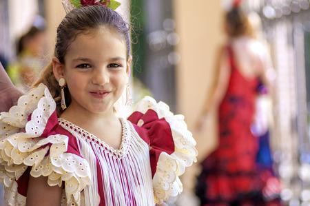 fiesta popular: MALAGA, SPAIN - AUGUST, 14: Little girls in flamenco style dress at the Malaga August Fair on August, 14, 2009 in Malaga, Spain Editorial