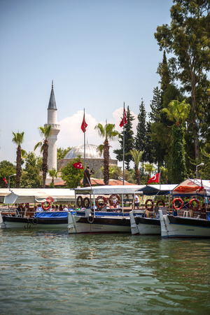 mugla: TURKEY, DALYAN, MUGLA - JULY 19, 2014: Touristic River Boats with tourists in the mouth of the Dalyan River