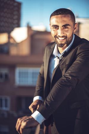 urban environment: Confident attractive Arab businessman in urban environment Stock Photo