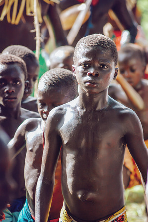 wrestle: SENEGAL - SEPTEMBER 19: Men and kids in the traditional struggle wrestle clothes of Senegal dancing before fighting, on September 19, 2007 in Casamance, Senegal Editorial