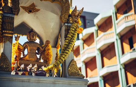 phrom: Phra Phrom altar in Bangkok street. Phra Phrom is the Thai representation of the Hindu god Brahma