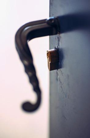 latch: opened metallic door with latch handle closeup