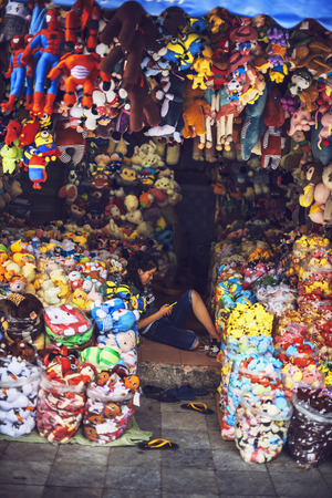 dummies: HANOI, JUNE 15, 2015: Stores in the street selling a lot of merchandising dolls, dummies and puppets, on June 15, 2015, in Hanoi, Vietnam Editorial