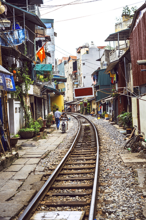 shanty: Hanoi, Vietnam - June 15, 2015: Usual life and houses on the railway track on June 15, 2015, in Hanoi, Vietnam. Editorial