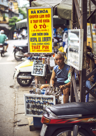 lon: HO CHI MINH CITY, VIETNAM - APR 18, 2015: The stalls of key makers and selling lockpads on the street of Cho Lon, on April 18, 2015, in Ho Chi Minh, Vietnam