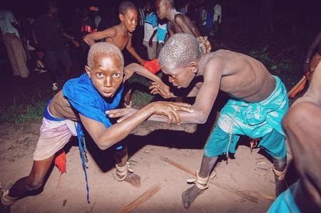 wrestle: SENEGAL - SEPTEMBER 19: Kids in the traditional struggle wrestle clothes of Senegal, September 19, 2007 in Casamance, Senegal Editorial