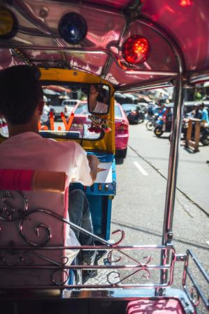traffic jams: BANGKOK - JUNE 10, 2015: An unidentified tuktuk driver stuck in a traffic jam, on June 10, 2015, in Bangkok, Thailand. Traffic jams are a constant in a city like Bangkok