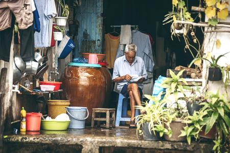 octogenarian: VINH LONG, VIETNAM -DECEMBER 29: Old Vietnamese man in the Mekong delta near Vinh Long on December 29,2013. The Mekong delta is a major tourist destination to experience rural Vietnam. Editorial