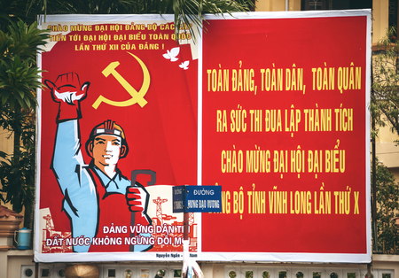 permitted: Saigon, Vietnam - Jan 1, 2015. Communist propaganda signs in Ho Chi Minh city, Vietnam. Only political organizations affiliated with the Communist Party are permitted to contest elections.