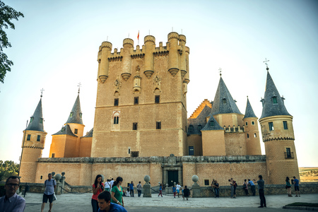 hill of the king: Segovia, Spain - July 12, 2014: People around the famous castle Alcazar of Segovia on July 12, 2014, in Segovia, Spain
