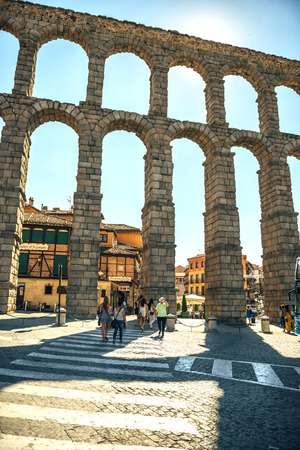 acueducto: Segovia, Spain - July 12, 2014: People around the famous ancient roman aqueduct on July 12, 2014, in Segovia, Spain