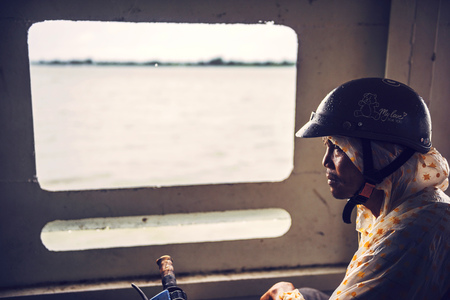 cramped: MEKONG DELTA - JUNE 14: Unidentified motorbike rider on a ship crossing the river, on June 14, 2015 in Mekong Delta, Vietnam