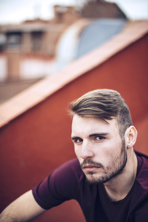 urban environment: Handsome caucasian young man in casual clothes in urban environment
