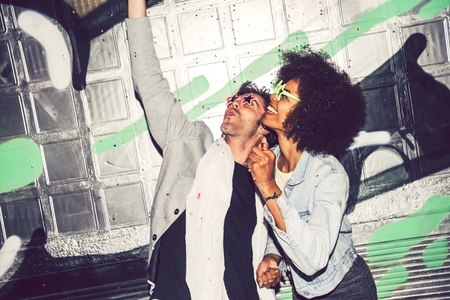 interracial couple: Interracial couple making party outdoor in the night