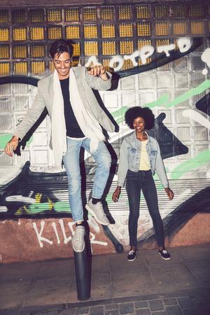 interracial couple: Young interracial couple having fun outdoors