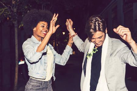 interracial couple: Happy interracial couple in a celebration