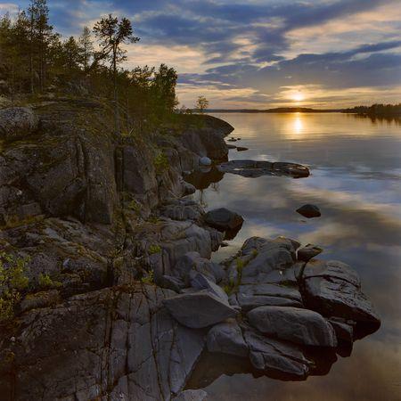 Sunset at stony shore of Ladoga lake, Russia Stock Photo - 6297819