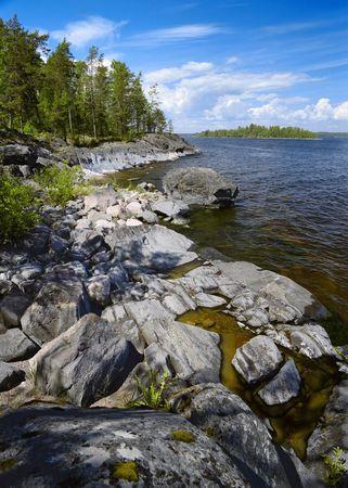 Stony shore of Ladoga lake, Russia Stock Photo