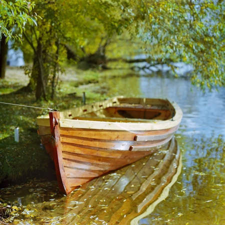 yellow boats: Boat at the shore of river