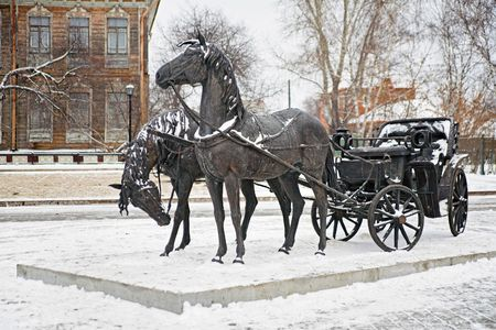 Sculpture A pair of horses harnessed to a carriage photo