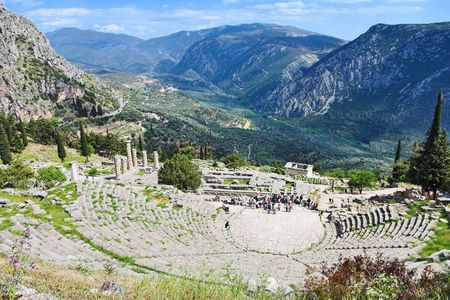 View of the amphitheater and the ruins of the temple of Apollo at Delphi, Greece photo