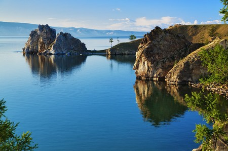 Cape Burhan and Shaman Rock on Olkhon Island at Baikal Lake, Russia photo