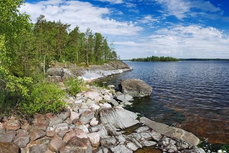 Stony shore of Ladoga lake, Russia photo