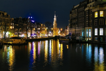 Evening view on the Munttoren (Coin Tower) from Amstel River in Amsterdam, Netherlands Stock Photo