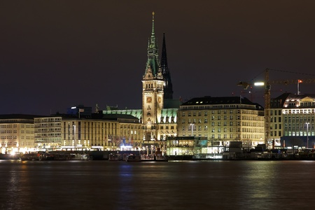 Night view of the Hamburg City Hall from the lake Binnenalster, Germany