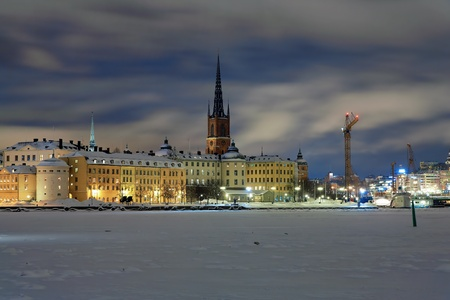 Stockholm, evening view of Riddarholmen island and Gamla Stan in winter, Sweden Stock Photo - 9361971