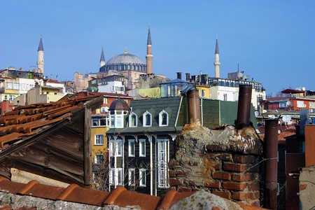 Hagia Sophia over the houses and roofs of Istanbul, Turkey photo