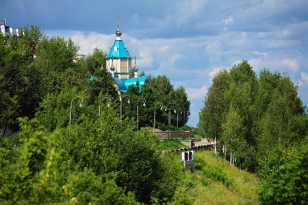 theodor: Embankment of river Vyatka and wooden Church of Theodor Icon of Mother of God in Kirov, Russia