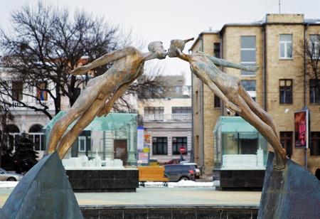 Flying in love - a sculpture in Kharkiv, Ukraine photo