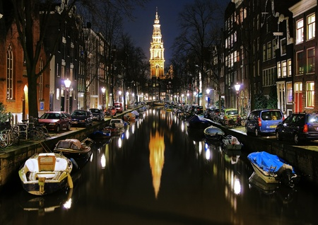 Evening view on the South church (Zuiderkerk) from channel in Amsterdam, Netherlands photo