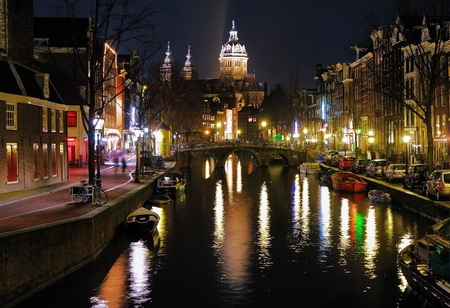 Evening view on the St. Nicolas Church (St. Nicolaaskerk) from channel in Amsterdam, Netherlands photo