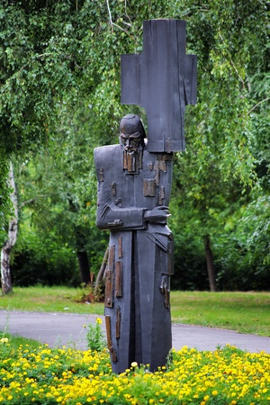 servitude: Carrying the Cross - Monument to the russian writer Dostoevsky in Omsk, Russia